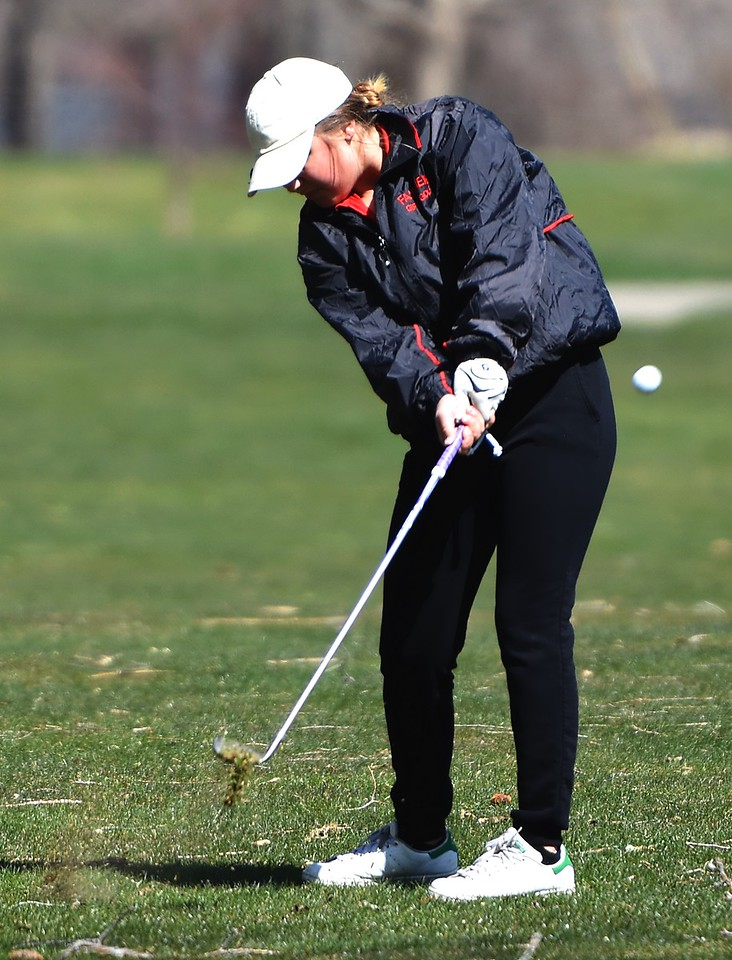 Fairview's Baeli Wein hits an approach shot during the Front Range League's first tournament of the season on Tuesday, April 3, at Flatirons Golf Course in Boulder.