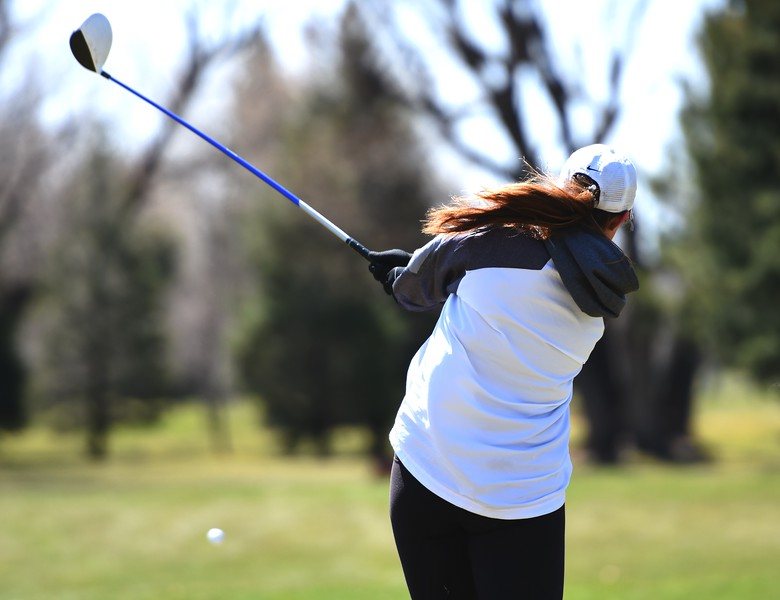 Boulder's Katie Bush hits a tee shot during the Front Range League's first tournament of the season on Tuesday, April 3, at Flatirons Golf Course in Boulder.