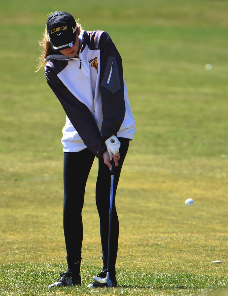 Boulder's Claire Boyles chips during the Front Range League's first tournament of the season on Tuesday, April 3, at Flatirons Golf Course in Boulder.