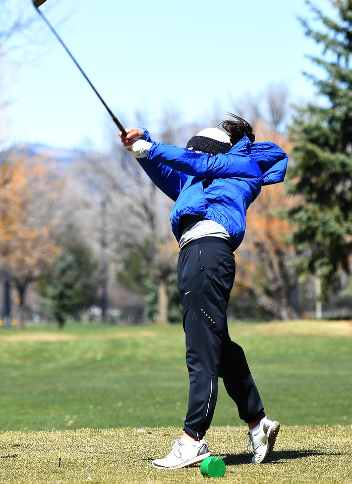 Broomfield's Megan Vogt hits a tee shot during the Front Range League's first tournament of the season on Tuesday, April 3, at Flatirons Golf Course in Boulder.