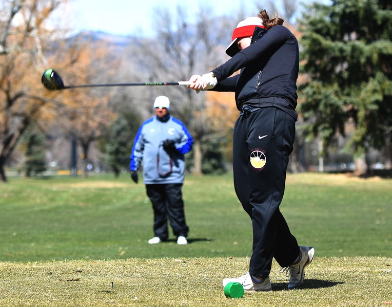 Fairview's Kelsey Webster tees off during the Front Range League's first tournament of the season on Tuesday, April 3, at Flatirons Golf Course in Boulder.