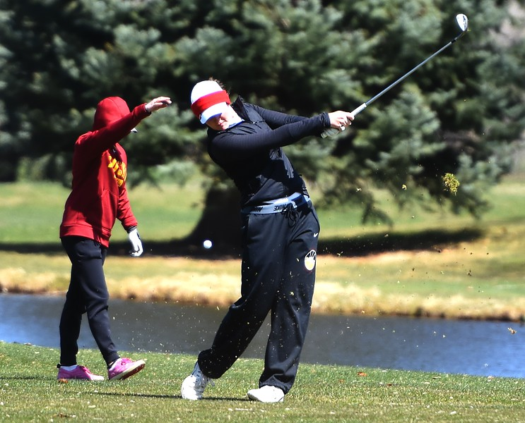 Fairview's Kelsey Webster hits an approach shot during the Front Range League's first tournament of the season on Tuesday, April 3, at Flatirons Golf Course in Boulder.