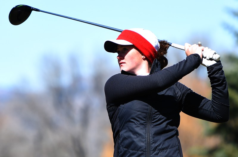 Fairview's Kelsey Webster watches a tee shot during the Front Range League's first tournament of the season on Tuesday, April 3, at Flatirons Golf Course in Boulder.