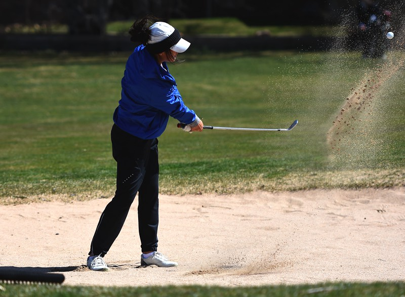 Broomfield's Megan Vogt hits  a shot out of the sand during the Front Range League's first tournament of the season on Tuesday, April 3, at Flatirons Golf Course in Boulder.