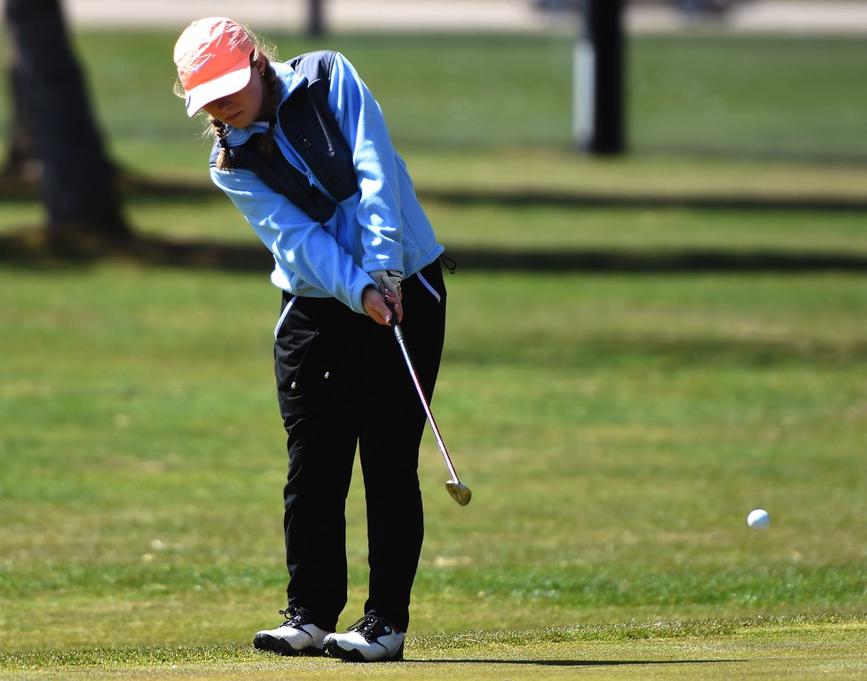 Broomfield's McKyln Madsen chips during the Front Range League's first tournament of the season on Tuesday, April 3, at Flatirons Golf Course in Boulder.