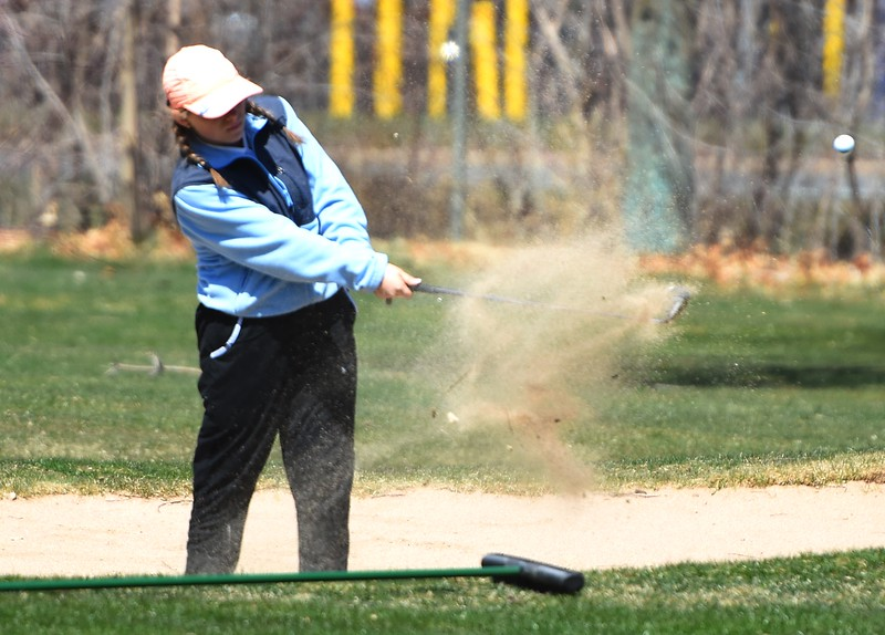 Broomfield's McKyln Madsen hits a shot out of a bunker during the Front Range League's first tournament of the season on Tuesday, April 3, at Flatirons Golf Course in Boulder.