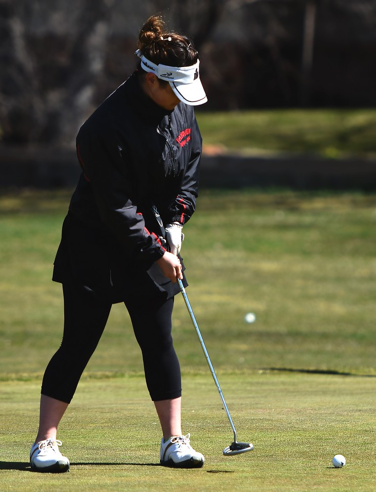 Fairview's Anna Bergman putts during the Front Range League's first tournament of the season on Tuesday, April 3, at Flatirons Golf Course in Boulder.