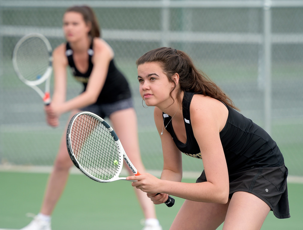 . LOVELAND, CO - APRIL 24: Monarch\'s Savannah Cook, left, and her sister Laura Cook compete in the number two doubles match against Fossil Ridge during the Front Range League Tournament at Loveland High School April 24, 2019. To view more photos visit bocopreps.com. (Photo by Lewis Geyer/Staff Photographer)