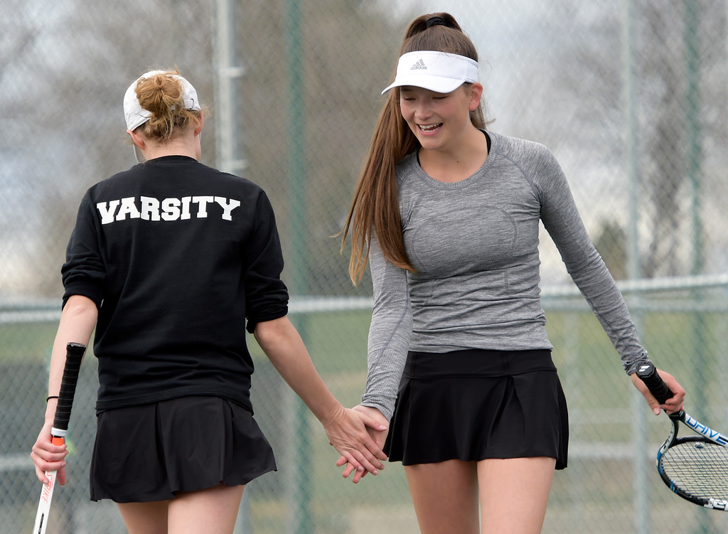 . LOVELAND, CO - APRIL 24: Monarch\'s Ginger Harrington, left, and Emma Lockner celebrate a point scored against Fossil Ridge during their number one doubles match at the Front Range League Tournament at Loveland High School April 24, 2019. To view more photos visit bocopreps.com. (Photo by Lewis Geyer/Staff Photographer)