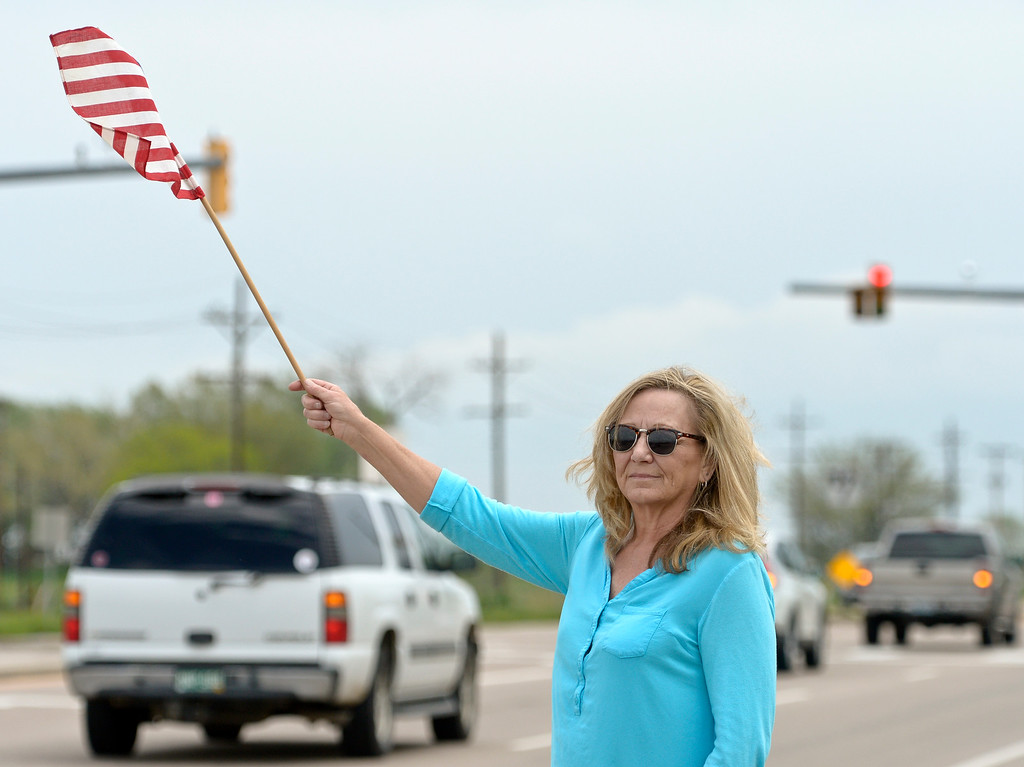 . Nancy Liebing, of Longmont, stands along Colo. 66 during the funeral procession for Army Spc. Gabriel Conde Monday afternoon. Conde was killed in action in Afghanistan April 30 at the age of 22. To view more photos and a video visit timescall.com. Lewis Geyer/Staff Photographer May 14, 2018
