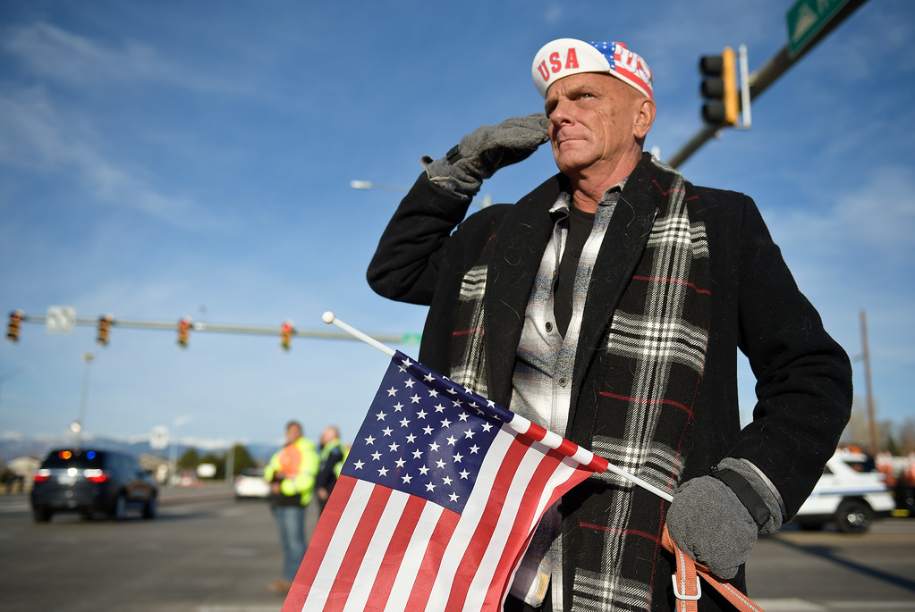. LONGMONT, CO - MARCH 21: Patrick McFarlane, of Longmont, salutes the funeral procession for Colorado State Patrol Cpl. Daniel Groves March 21, 2019. Groves was struck by a vehicle while assisting a motorist on I-76 during last week\'s blizzard. To view more photos visit timescall.com. (Photo by Lewis Geyer/Staff Photographer)