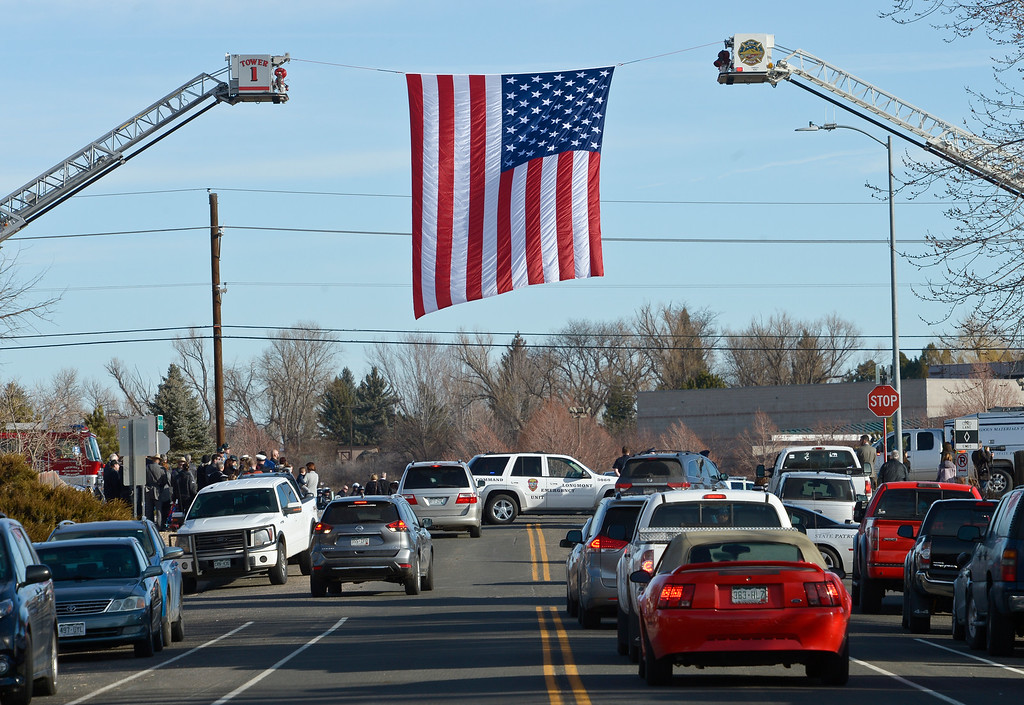. LONGMONT, CO - MARCH 21: An American flag hangs over the entrance to LifeBridge Church for the funeral for Colorado State Patrol Cpl. Daniel Groves March 21, 2019. Groves was struck by a vehicle while assisting a motorist on I-76 during last week\'s blizzard. To view more photos visit timescall.com. (Photo by Lewis Geyer/Staff Photographer)