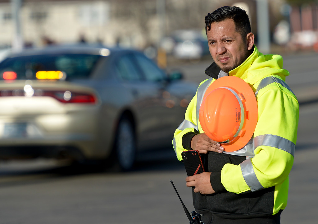 . LONGMONT, CO - MARCH 21: CDOT worker Miguel Tovar stands at Main Street and Colo. 66 for the funeral procession to LifeBridge Church for Colorado State Patrol Cpl. Daniel Groves March 21, 2019. Groves was struck by a vehicle while assisting a motorist on I-76 during last week\'s blizzard. To view more photos visit timescall.com. (Photo by Lewis Geyer/Staff Photographer)