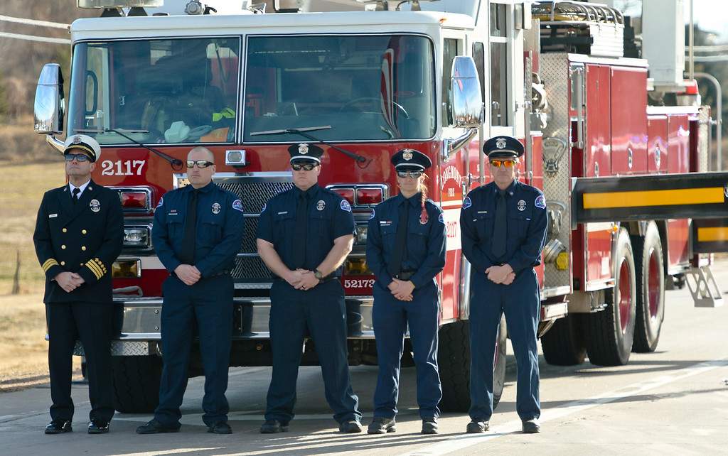 . LONGMONT, CO - MARCH 21: Longmont firefighters stand in front of a ladder truck during the funeral procession into LifeBridge Church for Colorado State Patrol Cpl. Daniel Groves March 21, 2019. Groves was struck by a vehicle while assisting a motorist on I-76 during last week\'s blizzard. To view more photos visit timescall.com. (Photo by Lewis Geyer/Staff Photographer)