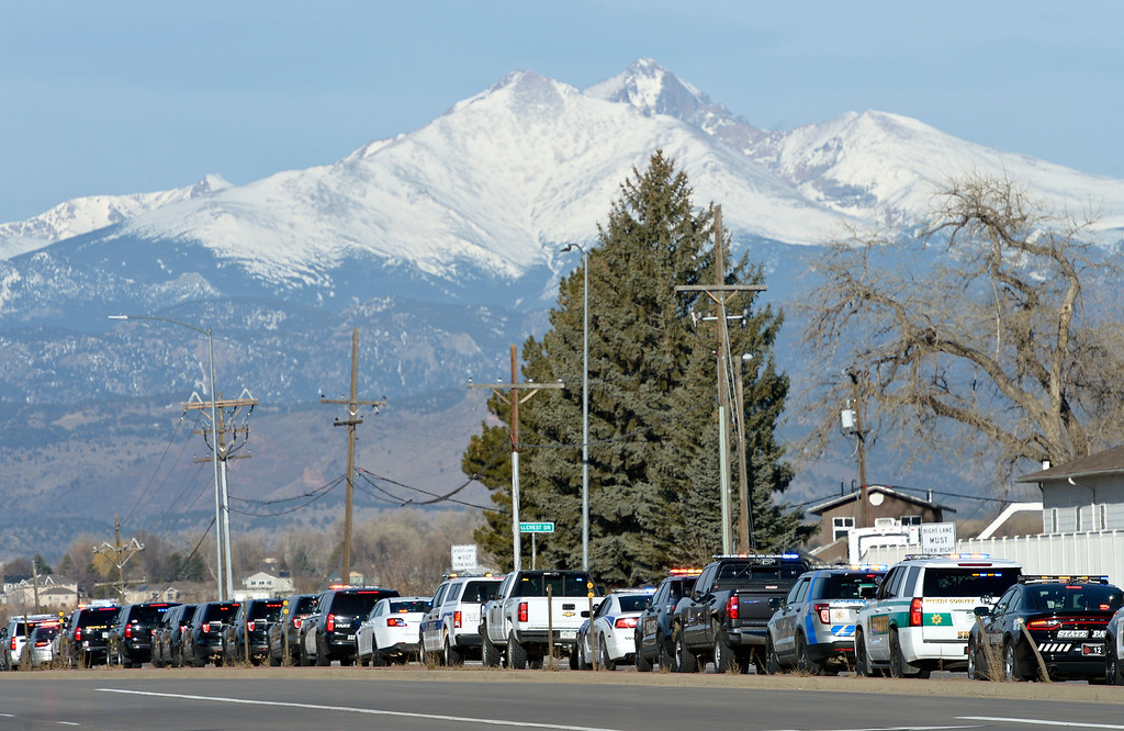 . LONGMONT, CO - MARCH 21: Numerous law enforcement vehicles wait to enter LifeBridge Church on Colo. 66 for the funeral for Colorado State Patrol Cpl. Daniel Groves March 21, 2019. Groves was struck by a vehicle while assisting a motorist on I-76 during last week\'s blizzard. To view more photos visit timescall.com. (Photo by Lewis Geyer/Staff Photographer)