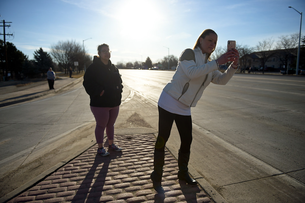 . LONGMONT, CO - MARCH 21: Coworkers Paulette Garcia, left, and Sherese Wilcutt wait at Main Street and Colo. 66 for the funeral procession to LifeBridge Church for Colorado State Patrol Cpl. Daniel Groves March 21, 2019. Groves was struck by a vehicle while assisting a motorist on I-76 during last week\'s blizzard. To view more photos visit timescall.com. (Photo by Lewis Geyer/Staff Photographer)