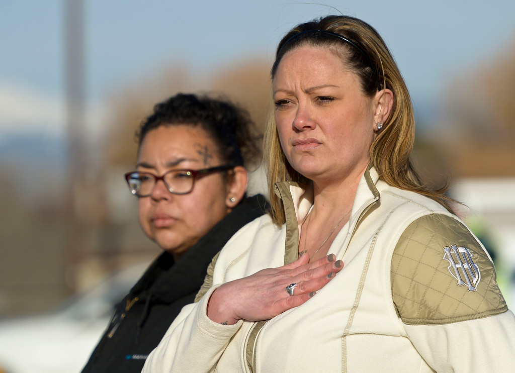 . LONGMONT, CO - MARCH 21: Coworkers Paulette Garcia, left, and Sherese Wilcutt watch at Main Street and Colo. 66 the funeral procession for Colorado State Patrol Cpl. Daniel Groves March 21, 2019. Groves was struck by a vehicle while assisting a motorist on I-76 during last week\'s blizzard. To view more photos visit timescall.com. (Photo by Lewis Geyer/Staff Photographer)