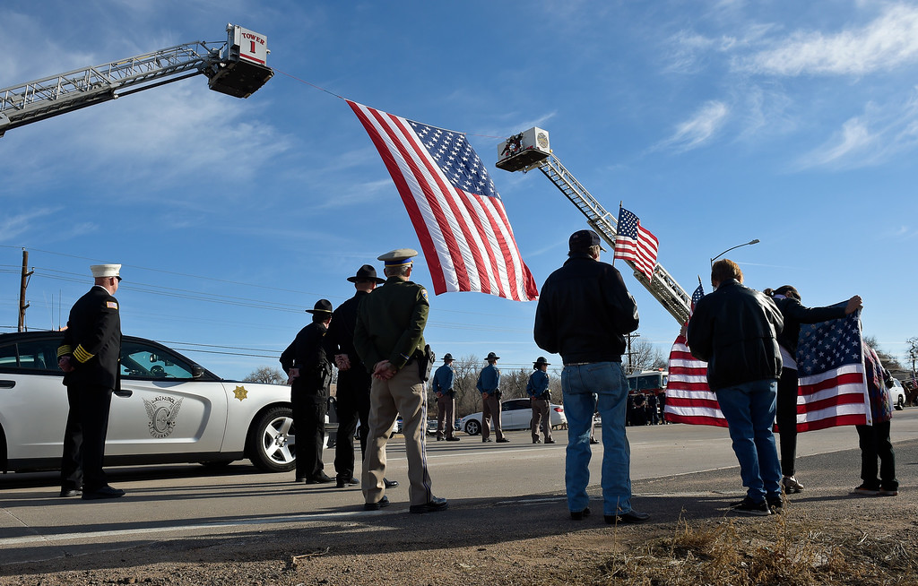 . LONGMONT, CO - MARCH 21: Bystanders watch the funeral procession into LifeBridge Church for Colorado State Patrol Cpl. Daniel Groves March 21, 2019. Groves was struck by a vehicle while assisting a motorist on I-76 during last week\'s blizzard. To view more photos visit timescall.com. (Photo by Lewis Geyer/Staff Photographer)