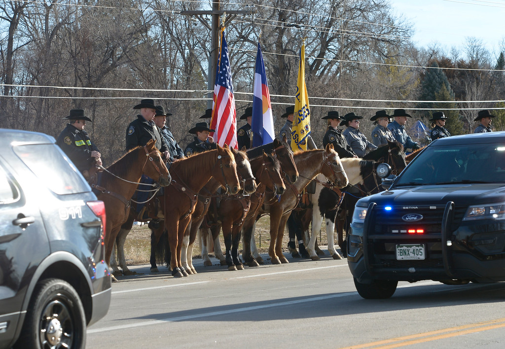 . LONGMONT, CO - MARCH 21: Mounted patrols stand along Colo. 66 for the funeral procession to LifeBridge Church for Colorado State Patrol Cpl. Daniel Groves March 21, 2019. Groves was struck by a vehicle while assisting a motorist on I-76 during last week\'s blizzard. To view more photos visit timescall.com. (Photo by Lewis Geyer/Staff Photographer)