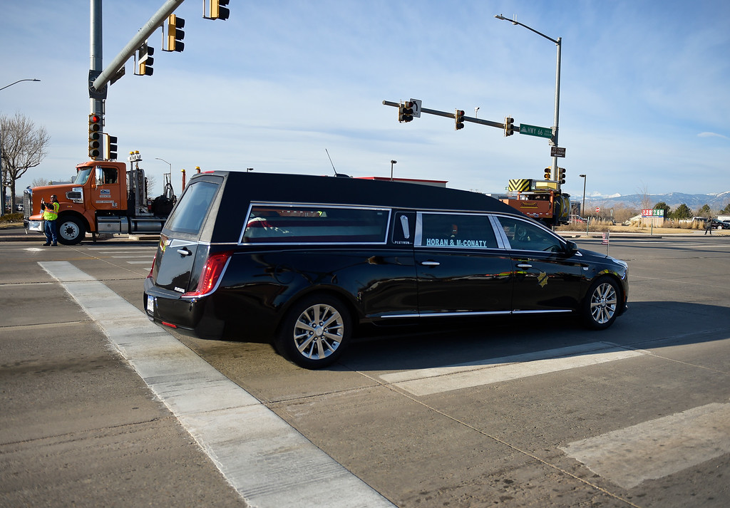 . LONGMONT, CO - MARCH 21: The hearse containing the casket of Colorado State Patrol Cpl. Daniel Groves passes through the intersection of Main Street and Colo. 66 March 21, 2019. Groves was struck by a vehicle while assisting a motorist on I-76 during last week\'s blizzard. To view more photos visit timescall.com. (Photo by Lewis Geyer/Staff Photographer)