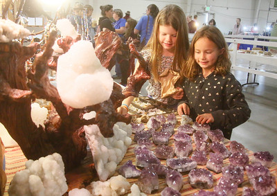 Redwood Coast Montessori students Lily Stoffers, 8, of Farihaven, left, and Charlie Luker, 7, of Eureka look at the Mountain Family Minerals tables at the Humboldt Gem and Mineral Show at Redwood Acres Fairgrounds on Friday. The event includes beautiful and educational rock and gem displays, geode cutting, a silent auction, games, demonstrations, and vendors. It continues today from 10 a.m. to 6 p.m. and Sunday from 10 a.m. to 5 p.m. (Shaun Walker -- The Times-Standard)