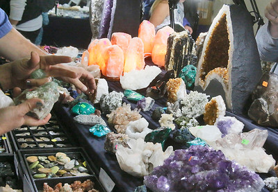 People look at rocks at the Cjem Minerals tables. (Shaun Walker -- The Times-Standard)