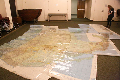 A woman looks at giant maps during GIS Day. (Shaun Walker -- The Times-Standard)