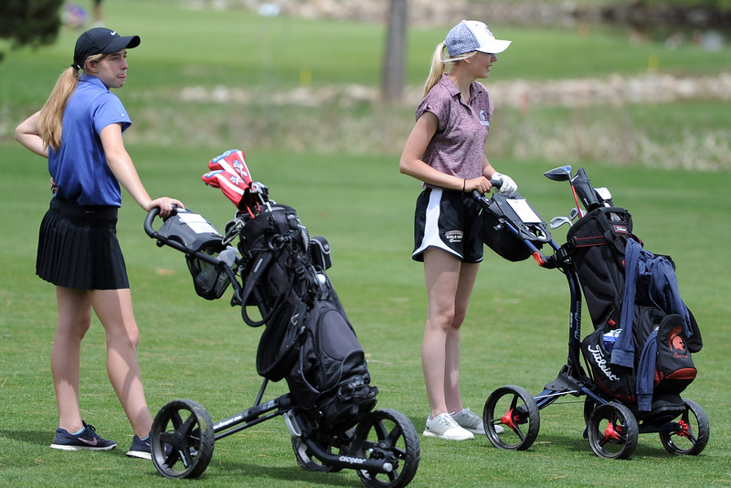 Resurrection Christian's Elisabeth Perl, left, and Berthoud's Kyra McDonald wait on the 13th fairway during the 3A Region 3 tournament on Monday at the Olde Course at Loveland. (Sean Star/Loveland Reporter-Herald)