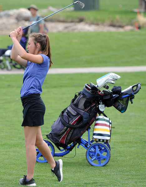 Resurrection Christian's Morgan Sailer watches an approach shot during the 3A Region 3 tournament on Monday at the Olde Course at Loveland. (Sean Star/Loveland Reporter-Herald)
