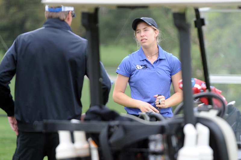 Resurrection Christian's Elisabeth Perl talks strategy with coach Eric Hinz during the 3A Region 3 tournament on Monday, May 7. 2018 at the Olde Course at Loveland. (Sean Star/Loveland Reporter-Herald)