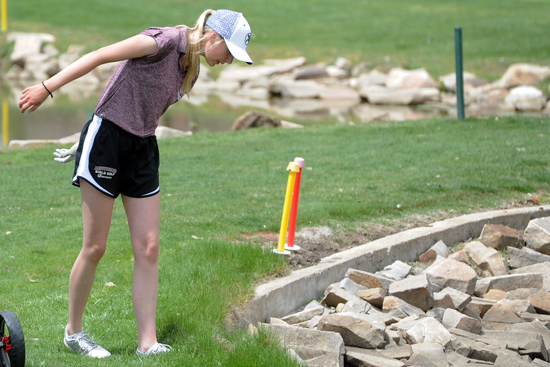 Berthoud's Kyra McDonald looks for her ball in a water hazard during the 3A Region 3 tournament on Monday, May 7, 2018 at the Olde Course at Loveland. (Sean Star/Loveland Reporter-Herald)