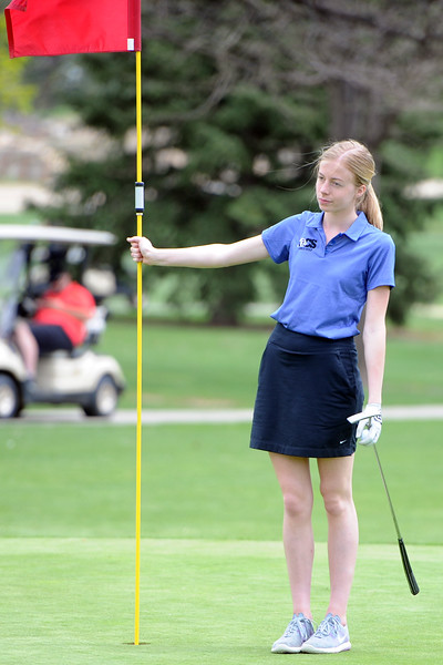 Resurrection Christian's Sloan Dando tends the flag during the 3A Region 3 tournament on Monday, May 7. 2018 at the Olde Course at Loveland. (Sean Star/Loveland Reporter-Herald)