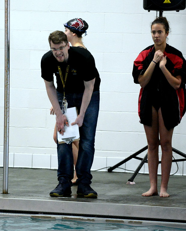 . Thompson Valley coach Trevor Ten Brink urges on one of his swimmers at Friday\'s District Championships at the Mountain View Aquatic Center. (Mike Brohard/Loveland Reporter-Herald)
