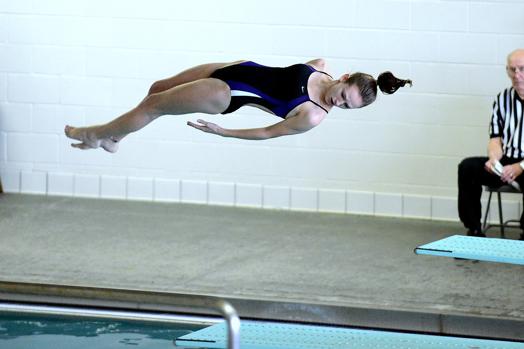. Mountain View\'s Laurene Powell spins through a dive at Friday\'s District Championships at the Mountain View Aquatic Center. (Mike Brohard/Loveland Reporter-Herald)