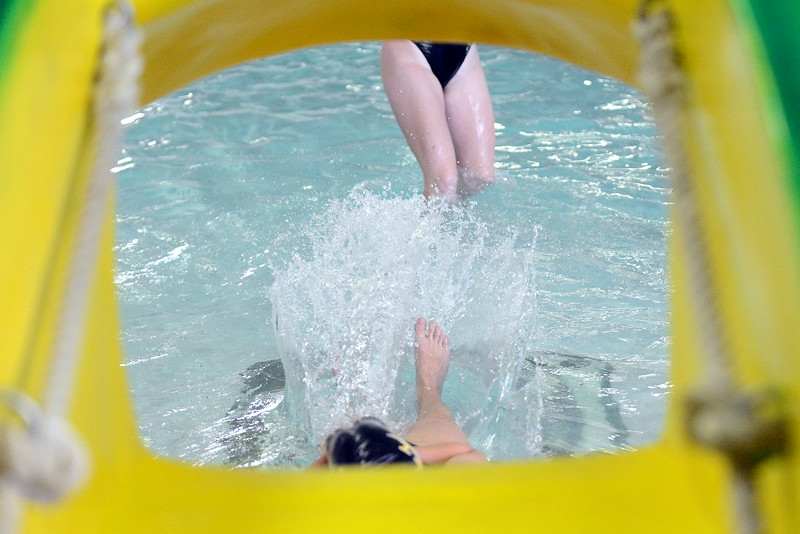 Thompson Valley's Ashton Hornick slides down the frog  at Friday's District Championships at the Mountain View Aquatic Center. (Mike Brohard/Loveland Reporter-Herald)