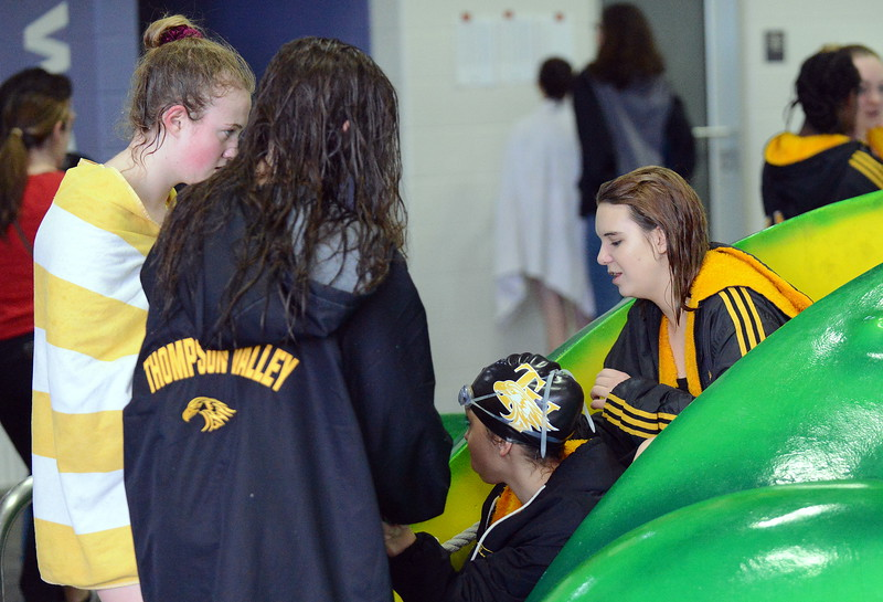 Thompson Valley swimmers share a bag of pretzels  at Friday's District Championships at the Mountain View Aquatic Center. (Mike Brohard/Loveland Reporter-Herald)