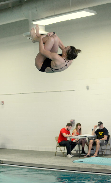 . Thompson Valley\'s Ryley Williams grabs her tuck during diving at the District Championships on Friday at the Mountain View Aquatic Center. The junior won the competition with a personal-best score of 231.xx. (Mike Brohard/Loveland Reporter-Herald)
