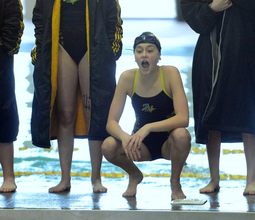 . Thompson Valley\'s Hayley Chapman cheers for her teammate at Friday\'s District Championships at the Mountain View Aquatic Center. (Mike Brohard/Loveland Reporter-Herald)