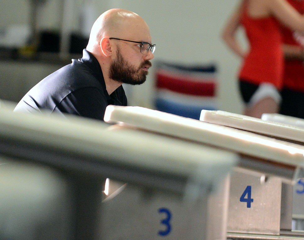 . Berthoud coach Matt Goldsmith watches his team warm up at Friday\'s District Championships at the Mountain View Aquatic Center. (Mike Brohard/Loveland Reporter-Herald)