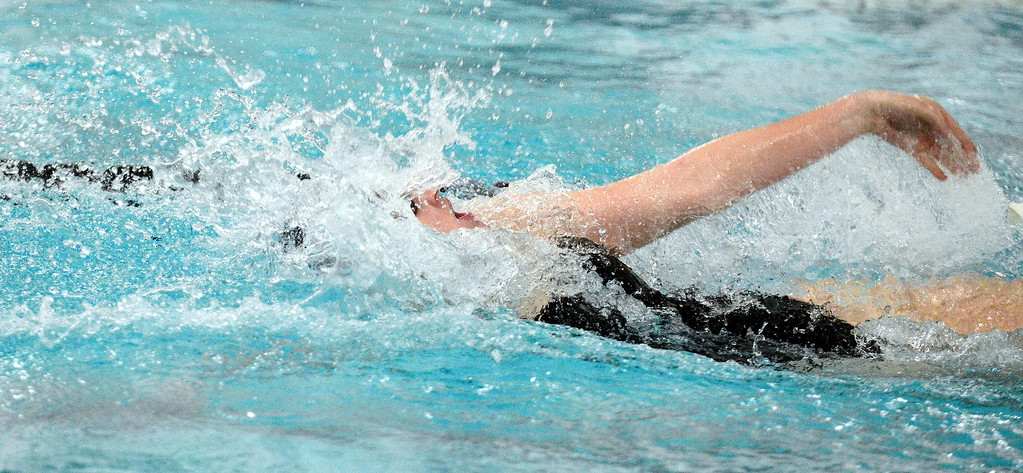 . Loveland\'s Erin Lang swims to a win in the 100-yard backstroke at Friday\'s District Championships at the Mountain View Aquatic Center. (Mike Brohard/Loveland Reporter-Herald)