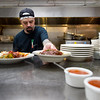 "Sous Chef Robbie Cocco prepares food in the kitchen at the Gondolier Italian Eater in Boulder on Friday. Gondolier will be opening up a new location in Longmont.  <br /> For more photos go to  <a href=""http://www.dailycamera.com"">http://www.dailycamera.com</a><br /> (Autumn Parry/Staff Photographer)<br /> August 26, 2016"