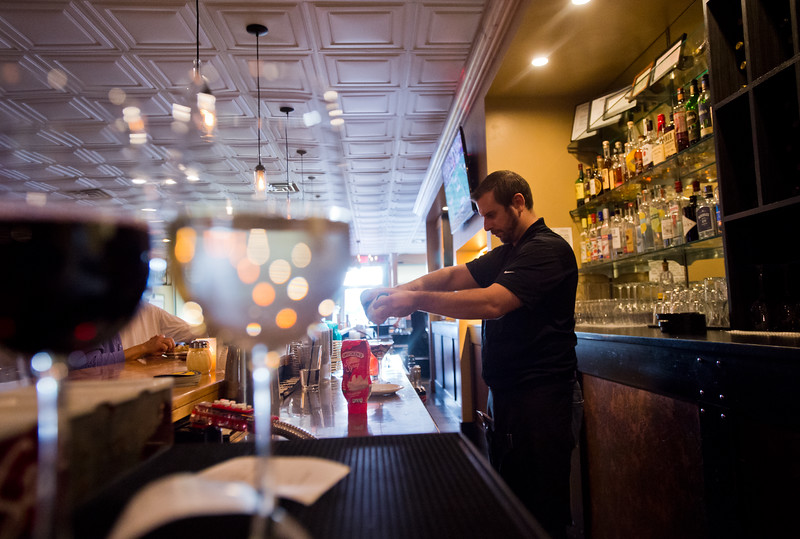 "Bar Manager Jeff Moyer prepares drinks behind the bar at the Gondolier Italian Eater in Boulder on Friday. Gondolier will be opening up a new location in Longmont.  <br /> For more photos go to  <a href=""http://www.dailycamera.com"">http://www.dailycamera.com</a><br /> (Autumn Parry/Staff Photographer)<br /> August 26, 2016"