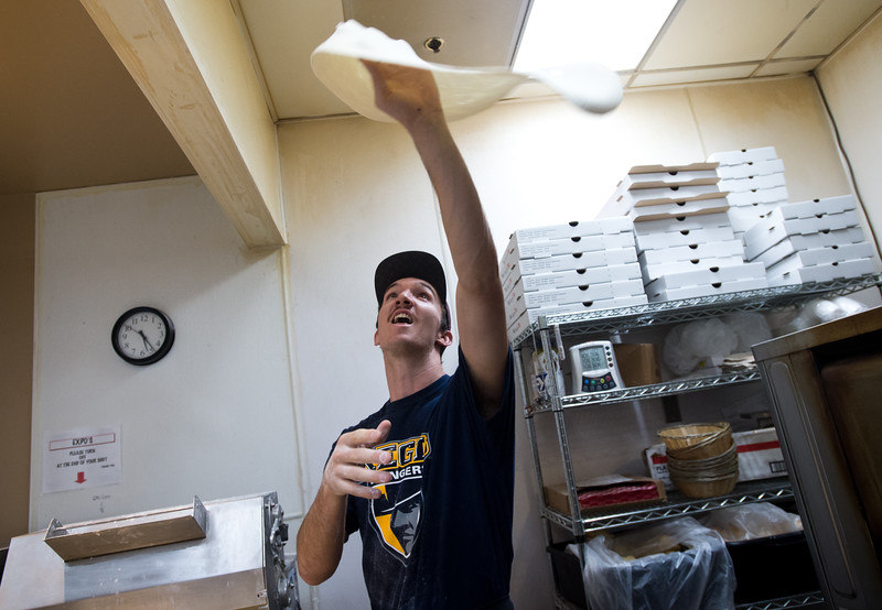 "Zack Fifer tosses pizza in the kitchen at the Gondolier Italian Eater in Boulder on Friday. Gondolier will be opening up a new location in Longmont.  <br /> For more photos go to  <a href=""http://www.dailycamera.com"">http://www.dailycamera.com</a><br /> (Autumn Parry/Staff Photographer)<br /> August 26, 2016"