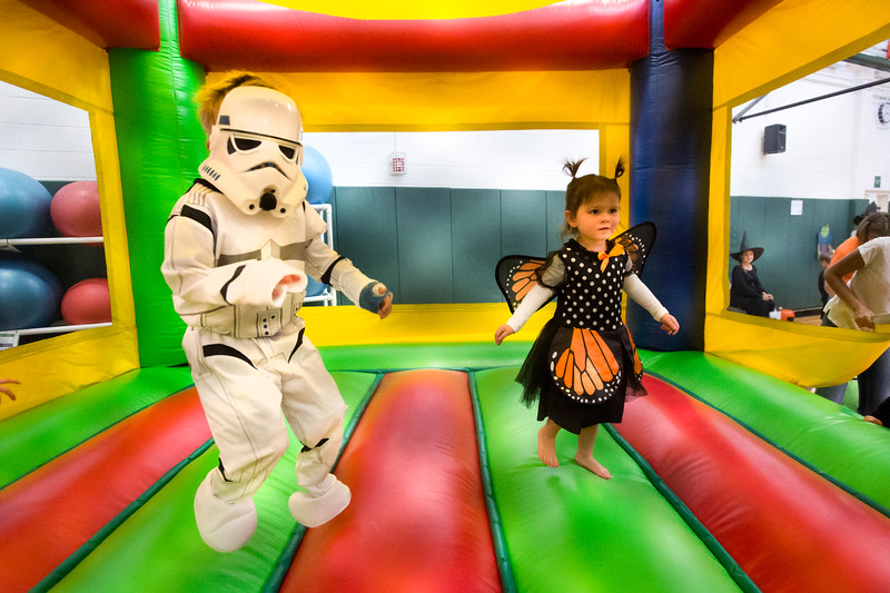 """Juniper Polston, 3, (right) plays in the bouncy house during the Halloween Carnival at the South Boulder Recreation Center on Friday.<br /> More photos:  <a href=""""http://www.dailycamera.com"""">http://www.dailycamera.com</a><br /> (Autumn Parry/Staff Photographer)<br /> October 28, 2016"""
