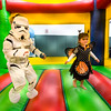 "Juniper Polston, 3, (right) plays in the bouncy house during the Halloween Carnival at the South Boulder Recreation Center on Friday.<br /> More photos:  <a href=""http://www.dailycamera.com"">http://www.dailycamera.com</a><br /> (Autumn Parry/Staff Photographer)<br /> October 28, 2016"