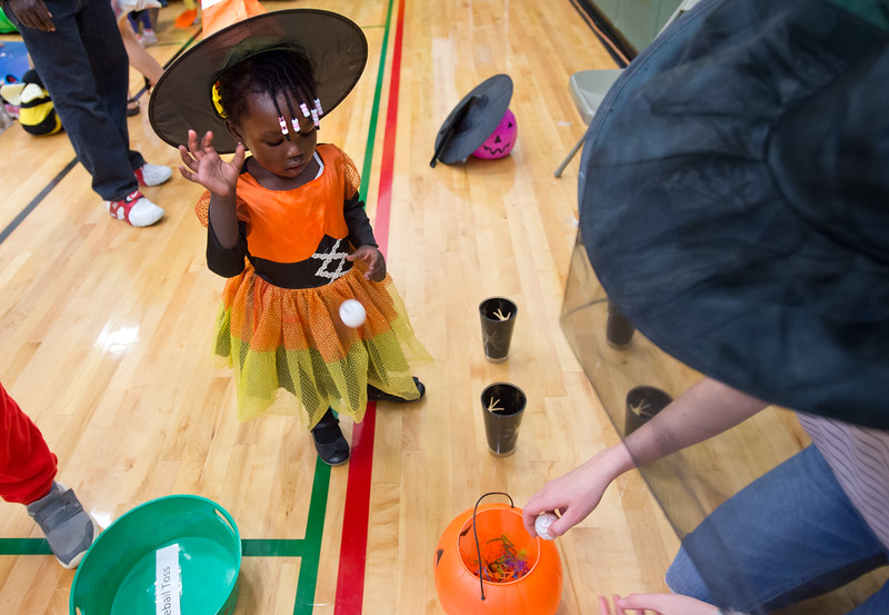 """Aaliyah Achulo, 2, plays a game during the Halloween Carnival at the South Boulder Recreation Center on Friday.<br /> More photos:  <a href=""""http://www.dailycamera.com"""">http://www.dailycamera.com</a><br /> (Autumn Parry/Staff Photographer)<br /> October 28, 2016"""
