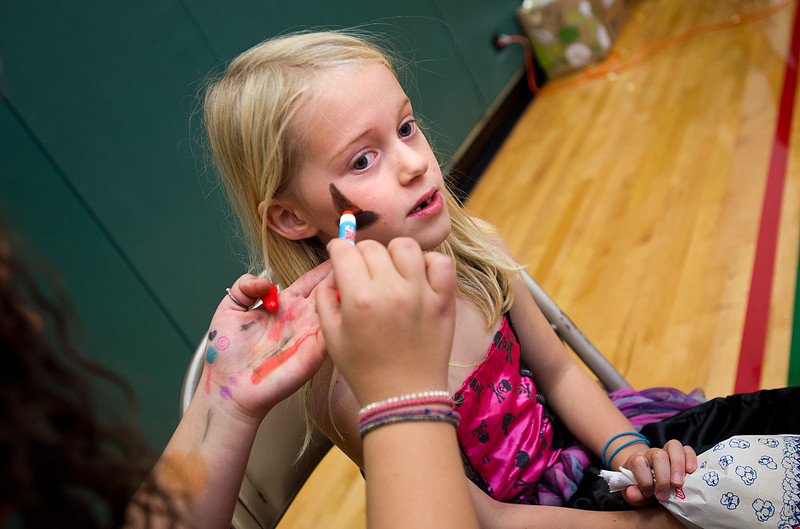 """Lily Sharp, 7, has her face painted during the Halloween Carnival at the South Boulder Recreation Center on Friday.<br /> More photos:  <a href=""""http://www.dailycamera.com"""">http://www.dailycamera.com</a><br /> (Autumn Parry/Staff Photographer)<br /> October 28, 2016"""