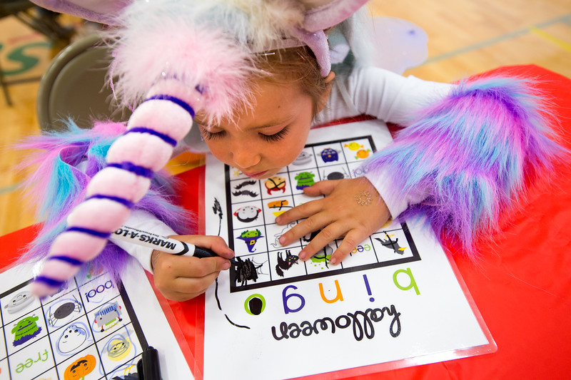 """Indira Rees, 4, plays bingo during the Halloween Carnival at the South Boulder Recreation Center on Friday.<br /> More photos:  <a href=""""http://www.dailycamera.com"""">http://www.dailycamera.com</a><br /> (Autumn Parry/Staff Photographer)<br /> October 28, 2016"""