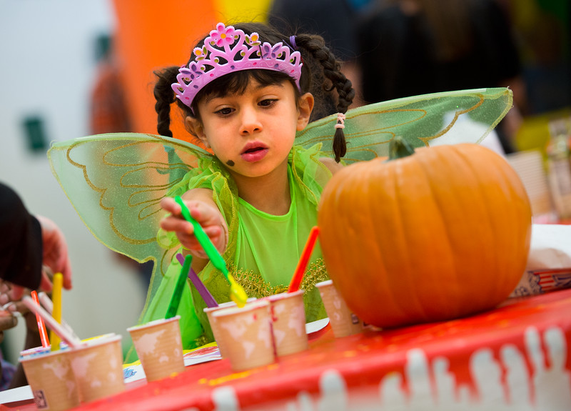 """Anisha Ayyalasomayajula, 4, paints during the Halloween Carnival at the South Boulder Recreation Center on Friday.<br /> More photos:  <a href=""""http://www.dailycamera.com"""">http://www.dailycamera.com</a><br /> (Autumn Parry/Staff Photographer)<br /> October 28, 2016"""
