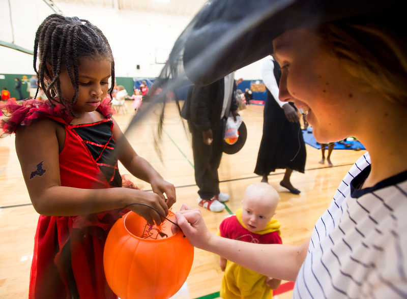 """Jasmine Nataba, 7, picks out a spider ring during the Halloween Carnival at the South Boulder Recreation Center on Friday.<br /> More photos:  <a href=""""http://www.dailycamera.com"""">http://www.dailycamera.com</a><br /> (Autumn Parry/Staff Photographer)<br /> October 28, 2016"""
